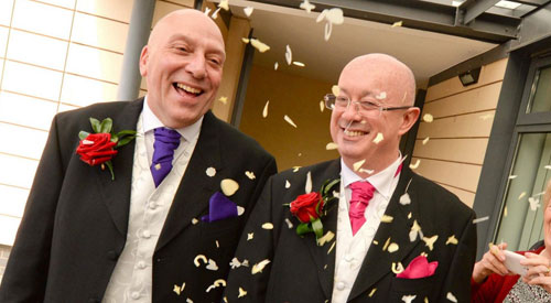 Long-term partners become the first gay couple to marry in Birmingham