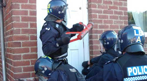 Police swoop on looters' homes around Birmingham
